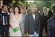 EVA LANSKA; PHARRELL WILLIAMS, 2014 Serpentine's summer party sponsored by Brioni.with a pavilion designed this year by Chilean architect Smiljan Radic  Kensington Gdns. London. 1July 2014