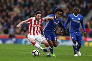 Joe Allen of Stoke city holds off Willian of Chelsea. Premier league match, Stoke City v Chelsea at the Bet365 Stadium in Stoke on Trent, Staffs on Saturday 18th March 2017.<br /> pic by Andrew Orchard, Andrew Orchard sports photography.