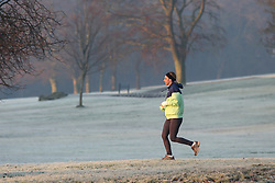 © Licensed to London News Pictures. 24/01/2017. Leeds, UK. A man jogs on a bitterly cold and frosty morning at Roundhay Park in Leeds, West Yorkshire. Temperatures have dropped below freezing this morning across the country causing travel problems for many commuters. Photo credit : Ian Hinchliffe/LNP