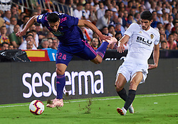September 26, 2018 - Valencia, U.S. - VALENCIA, SPAIN - SEPTEMBER 26: Facundo Roncaglia, defender of RC Celta de Vigo competes for the ball with Gonalo Guedes, of Valencia CF during the La Liga match between Valencia CF and RC Celta de Vigo at Mestalla Stadium on September 26, 2018 in Valencia, Spain. (Photo by Carlos Sanchez Martinez/Icon Sportswire) (Credit Image: © Carlos Sanchez Martinez/Icon SMI via ZUMA Press)