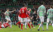16.03.2013 Glasgow, Scotland. Charlie Mulgrew's shot is deflected into the net  during the Clydesdale Bank Premier League match between, Celtic and Aberdeen, from Celtic Park Stadium.