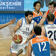 Anadolu Efes's Cenk Akyol (C) during their Turkish Basketball League match Anadolu Efes between Mersin BSB at Sinan Erdem Arena in Istanbul, Turkey, Saturday, January 14, 2012. Photo by TURKPIX