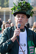 Conservationist and broadcaster Chris Packham speaks outside Buckingham Palace following a Rewild Royal Land procession organised by Wild Card, a new campaign calling on the UK's biggest landowners to rewild, and 38 Degrees on 9th October 2021 in London, United Kingdom. Campaigners are calling on the Royal Family, the largest landowning family in the UK, to rewild their estates in order to assist with tackling the climate crisis and a 14-year-old boy presented a petition at the gates of Buckingham Palace signed by over 100,000 people.