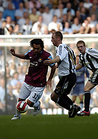 Photo: Olly Greenwood.<br />West Ham United v Newcastle United. The Barclays Premiership. 17/09/2006. West Ham United's Carlos Teves and Newcastle's Craig Moore