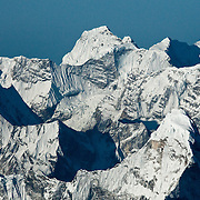 The jumbled and jagged peaks of the Khumbu Himalaya, Nepal, as seen at sunrise from the South Summit of Mount Everest, Nepal.