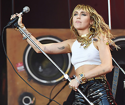 Miley Cyrus and Billy Ray Cyrus at the 2019 Glastonbury Music Festival. 30 Jun 2019 Pictured: Miley Cyrus, Mark Ronson. Photo credit: MEGA TheMegaAgency.com +1 888 505 6342