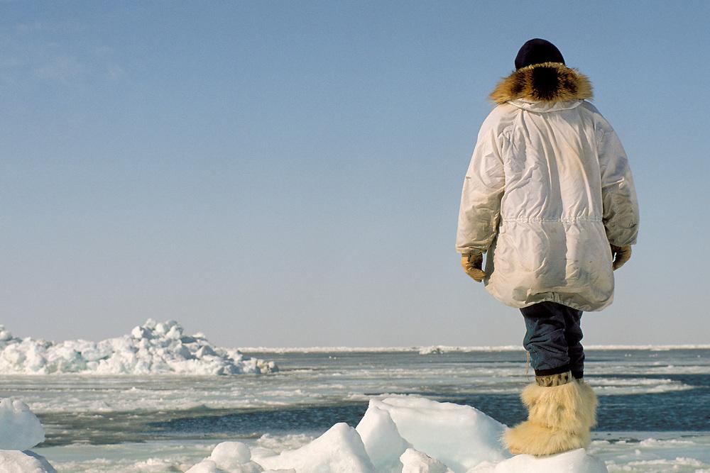 Barrow, Alaska, Native whaler on lookout for a bowhead whale on the edge of sea ice on the Chukchi Sea