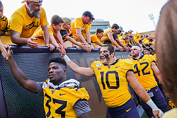 Sep 14, 2019; Morgantown, WV, USA; West Virginia Mountaineers linebacker Dylan Tonkery (10) celebrates with fans after beating the North Carolina State Wolfpack at Mountaineer Field at Milan Puskar Stadium. Mandatory Credit: Ben Queen-USA TODAY Sports