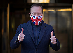 © Licensed to London News Pictures. 30/12/2020. London, UK. Health Secretary Matt Hancock gives a thumbs up as he leaves television studios near Parliament. The Medicines and Healthcare products Regulatory Agency (MHRA) has authorised the Oxford University Astra Zeneca coronavirus vaccine for use in the UK. Photo credit: Peter Macdiarmid/LNP
