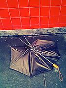 A broken umbrella after a storm in New York City.