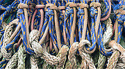 Knots and loops on fishing nets in a pile of netting on Bainbridge Island, Washington.
