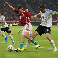 Adam Szalai (C) of Hungary and Sebastian Coates (R) of Uruguay fight for the ball during the inauguration match of the newly reconstructed Ferenc Puskas Stadium between Hungary and Uruguay in Budapest, Hungary on Nov. 15, 2019. ATTILA VOLGYI