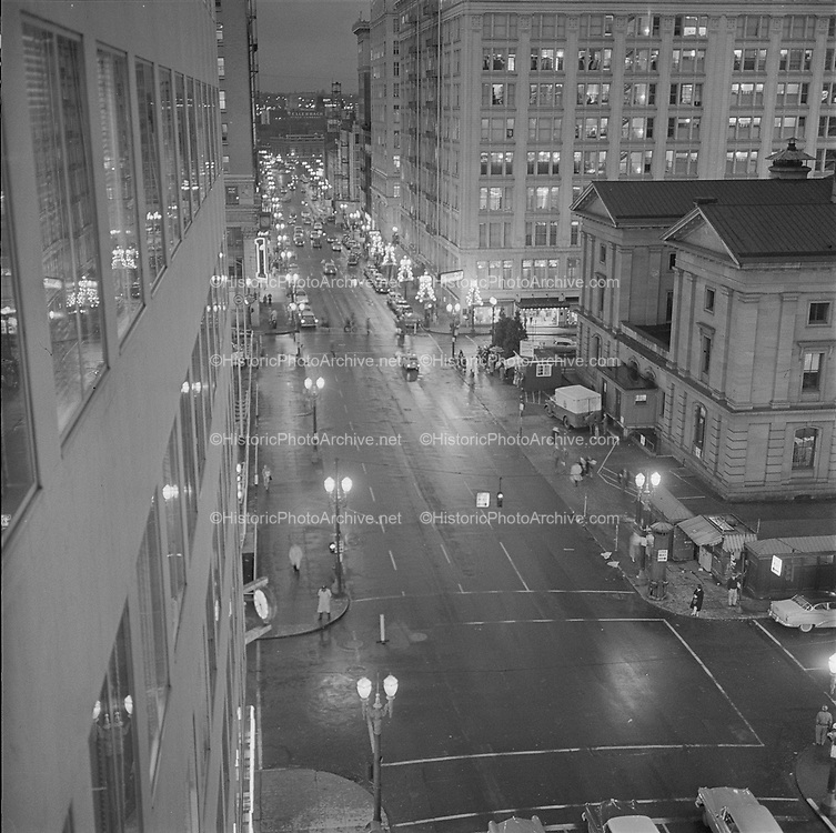 Y-581226A-04. Night view of SW 6th looking north from Yamhill. December 26, 1958.