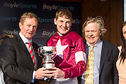 Horse Racing - Fairyhouse Easter Festival, Monday 28th March 2016<br /> An Taoiseach Enda Kenny presents the trophy to Ger Fox and Owner Mouse Morris after winning the Irish Grand National on Rogue Angel<br /> Photo: David Mullen /www.cyberimages.net / 2016