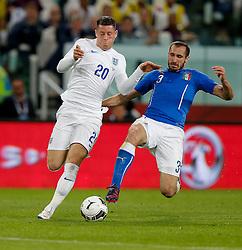 Ross Barkley of England is challenged by Giorgio Chiellini (capt) of Italy - Photo mandatory by-line: Rogan Thomson/JMP - 07966 386802 - 31/03/2015 - SPORT - FOOTBALL - Turin, Italy - Juventus Stadium - Italy v England - FIFA International Friendly Match.