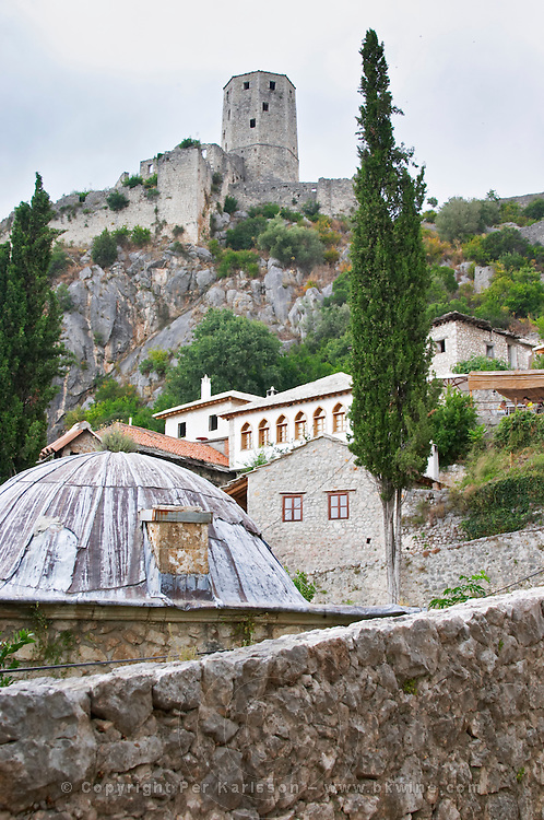 View over the city with tower, fortress, houses and domed roof. Pocitelj historic Muslim and Christian village near Mostar. Federation Bosne i Hercegovine. Bosnia Herzegovina, Europe.