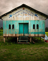 LORETO, PERU - CIRCA OCTOBER 2015:  Abandoned church around the Yarapa river. Village of Puerto Miguel in the Peruvian Amazon.