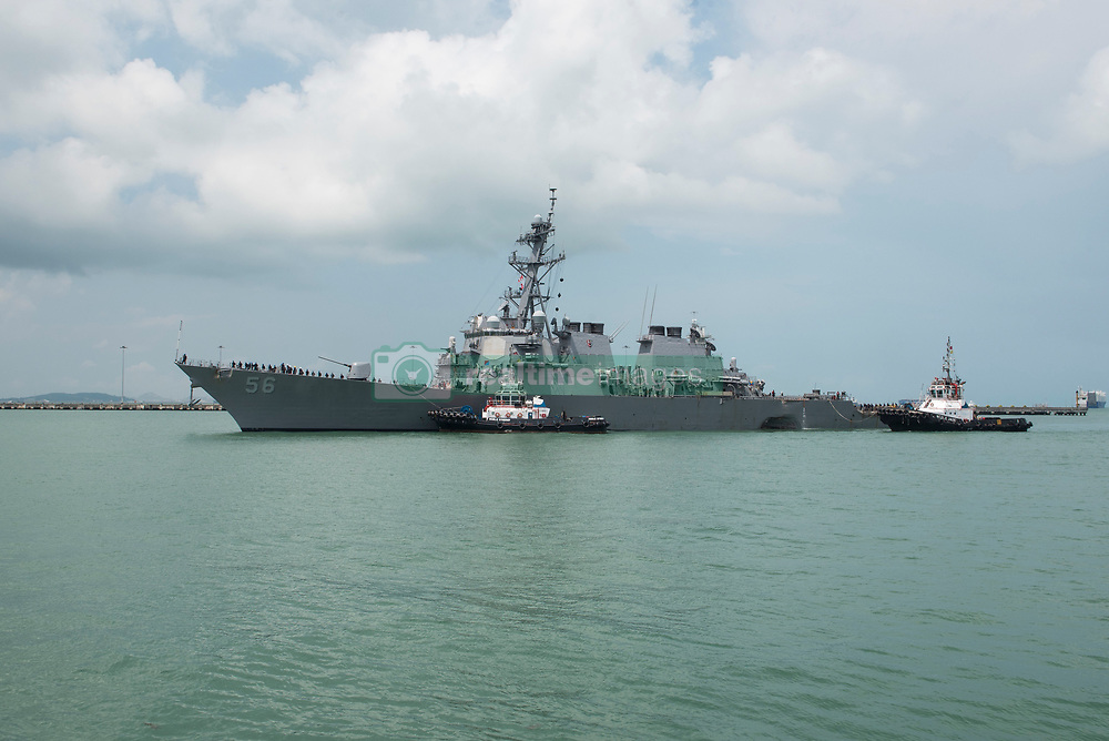 August 21, 2017 - Singapore, Singapore - The USN Arleigh Burke-class guided-missile destroyer USS John S. McCain with a damaged hull section is assisted into the dock at Changi Naval Base for emergency repairs August 21, 2017 in Singapore. The ship collided with the civilian merchant vessel Alnic MC while underway east of the Straits of Malacca resulting in significant damage and 10 sailors missing and believed dead. (Credit Image: © Grady Fontana/Planet Pix via ZUMA Wire)
