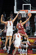 Stanford Cardinal forward Spencer Jones (14) attempts a reverse layup past Southern California Trojans forward Isaiah Mobley (3) during an NCAA men's basketball game, Wednesday, March 3, 2021, in Los Angeles. USC defeated Stanford 79-42. (Jon Endow/Image of Sport)