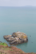 Cliff divers jump into Dublin Bay on 09th April 2017 in County Dublin, Republic of Ireland. Howarth Cliff Path, at Howth Head, is a peninsula just 15km northeast of Dublin City.