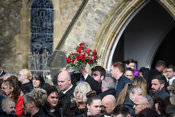"© Licensed to London News Pictures. 14/02/2020. Sevenoaks, UK. Flowers are carried from St John the Baptist church in Sevenoaks, Kent following the funeral service of traveller brothers Billy and Joe Smith. The twin brothers, who were made famous by the television programme ""My Big Fat Gypsy Wedding"", were found hanged in woodland three days after Christmas. Photo credit: Ben Cawthra/LNP"
