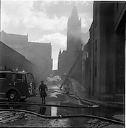 05/07/1961<br /> 07/05/1961<br /> 05 July 1961<br />  A fire at Powers Distillery, John's Lane, Dublin. The fire fortunately occurred during a period when the distillery was not in use, but a warehouse containing 4000 hogsheads of maturing whiskey was destroyed. Picture shows Firemen and fire engine  with John's Lane Church in the background.