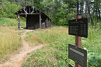 Patrol cabin and trail sign on Kintla Lake trail Glacier National Park