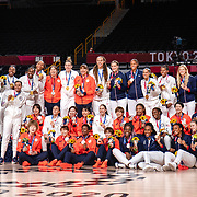 TOKYO, JAPAN August 8:  Five-time Olympic gold medalists Diana Taurasi, (left) and Sue Bird of the United States sit with the Japanese team during a group photograph with all the medalist after the United States victory during the Japan V USA basketball final for women at the Saitama Super Arena during the Tokyo 2020 Summer Olympic Games on August 8, 2021 in Tokyo, Japan. (Photo by Tim Clayton/Corbis via Getty Images)