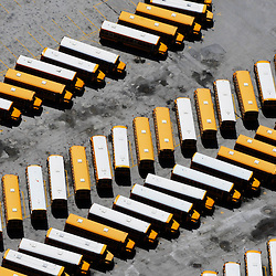 Aerial view of rows of buses