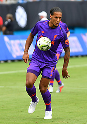 July 22, 2018 - Charlotte, NC, U.S. - CHARLOTTE, NC - JULY 22: Liverpool defender Virgil van Dijk (4) works the ball in the corner during an International Champions Cup match between LiverPool FC and Borussia Dortmund on July 22 2018 at Bank Of America Stadium in Charlotte,NC.(Photo by Dannie Walls/Icon Sportswire) (Credit Image: © Dannie Walls/Icon SMI via ZUMA Press)