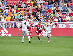 September 22, 2018 - Harrison, New Jersey, United States - Alejandro Romero Gamarra (10) of New York Red Bulls & Jonathan Osorio (21) of Toronto FC fight for ball during regular MLS game at Red Bull Arena Red Bulls won 2 - 0 (Credit Image: © Lev Radin/Pacific Press via ZUMA Wire)