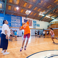 061913        Brian Leddy<br /> Coach Amelia Holtsoi goes over drills with players during a volleyball camp in Window Rock Wednesday.