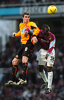 Andy Gray (Sheffield United) Chris Powell (West Ham) Credit: Back Page Images / Matthew Impey. West Ham United v Sheffield United, The Coca Cola Championship, 3/01/2004.
