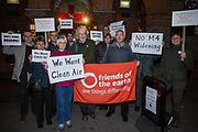 Environmental campaigners protest outside the venue for a public meeting to discuss plans to convert a section of the M4 motorway into a 'smart motorway' on 16th November 2015 in Reading, United Kingdom. The campaigners, from groups including Friends of the Earth, are opposed to the plans for a smart motorway with no hard shoulder between London and Reading on the grounds of safety, noise, air pollution, climate change impact and cost.