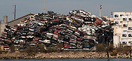 Flattened automobiles are stacked and ready for shredding at the Schnitzer Steel metal recycling facilities at the Port of Oakland in Oakland, Calif.,  on Saturday, Sept. 17, 2011.  (© 2011 Cindi Christie/Cyanpixel Photography)