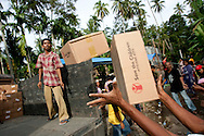 Tanjung, Western Sumatra, Indonesia, 8th October 2009: International charity Save the Children hands out Hygeine Kits and Tarpaulins to the villagers of Tanjung following the devastating earthquake in Western Sumatra that claimed the lives of an estimated 2000 people.?photo: Joseph Feil