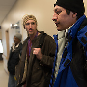 Date: 2/6/15<br /> Desk: SCI<br /> Slug: SUPER UTILIZERS<br /> Assign Id: 30170556A<br /> <br /> TJ Redig, 28, left, a case manager for the Hennepin Health RESOURCE Chemical and Mental Health emergency department in reach program in Minneapolis (Hennepin County), Minnesota accompanies his client Prugh Jose, 42, who is homeless, to a scheduled dental appointment at the Hennepin County Medical Center's Dental & Oral Surgery Clinic on February 6, 2015. <br /> <br /> Photo by Angela Jimenez for The New York Times <br /> photographer contact 917-586-0916