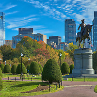 Boston fall foliage photography of the Boston Public Garden with downtown skyline on a magical autumn late afteroon.<br />