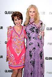 Nicole Kidman (right) receives the Film Actress Award from Kathy Lette (left) in the press room at the Glamour Women of the Year Awards 2017, Berkeley Square Gardens, London.