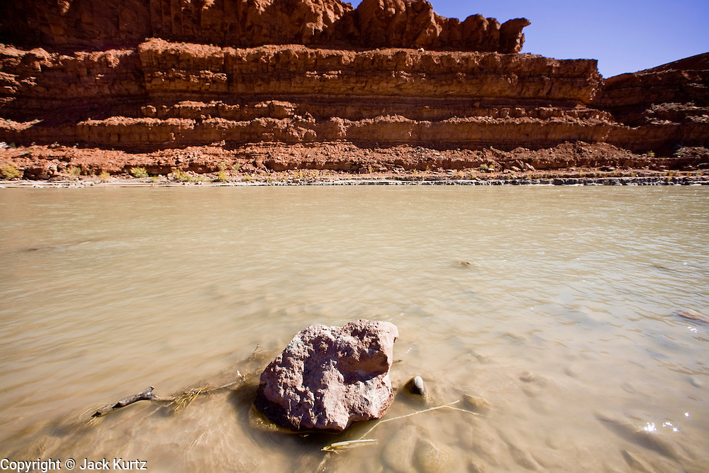 22 OCTOBER 2007 -- MEXICAN HAT, UT: The San Juan River as it flows through Mexican Hat, UT. The San Juan is one of the most important rivers on the Navajo Indian Reservation but the tribe has never been able to rights to divert adequate water from the river. More than 30 percent of the homes on the Navajo Nation, about the size of West Virginia and the largest Indian reservation in the US, don't have indoor plumbing or a regular supply of domestic water. Many of these homes have to either buy water from commercial vendors or haul water from public wells. A Federal study showed that the total cost of hauling water was about $113 per 1,000 gallons. A Phoenix household, in comparison, pays just $5 a month for up to 7,400 gallons of water. The lack of water on the reservation means the Navajo are among the most miserly users of water in the United States. Families that have to buy or haul water use only about 15 gallons of water per day per person. In Phoenix, by comparison, the average water use is about 170 gallons per day.  Photo by Jack Kurtz