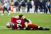 San Francisco 49ers offensive tackle Joe Staley (74) lays on the field injured during a NFL game against the Seattle Seahawks at Levi's Stadium in Santa Clara, Calif., on November 26, 2017. (Stan Olszewski/Special to S.F. Examiner)