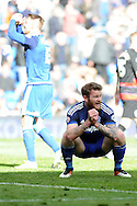 Cardiff City's Aron Gunnarsson (crouching) can't believe a late chance misses the target. Skybet football league championship match, Cardiff city v Queens Park Rangers at the Cardiff city stadium in Cardiff, South Wales on Saturday 16th April 2016.<br /> pic by Carl Robertson, Andrew Orchard sports photography.