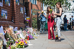 © Licensed to London News Pictures. 20/06/2017. London, UK. Two young women leave flowers outside Finsbury Park Mosque in North London, close to the scene of the attack. A man drove a white van into a crowd of Muslims in Finsbury Park after Ramadan prayers early on the morning of Monday 19 June 2017, killing one man and injuring a number of others. Photo credit: Rob Pinney/LNP