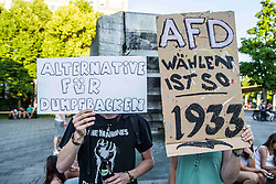 """June 19, 2017 - Munich, Germany - Two youth protestors. The far- to radical-right and populist AfD party and speaker Wolfgang Wiehle held a rally at Munich's Schweizer Platz, which drew approximately 75 supporters, many from the Pegida-Munich circles, as well as several in neo-nazi circles. Approximately 50 peaceful counter-demonstrators organized by the SPD party and Muenchen ist Bunt group were also in attendance.  Only one altercation arose when a member of the public and NOT part of the demonstrators approached the stage and created a minor disturbance.  The theme of the speech was """"Buerger an der Macht"""" (""""Power to the People"""") and Schweizer Platz was chosen as a tie-in to the AfD's concept of using the Swiss example to handle immigration and foreigners. (Credit Image: © Sachelle Babbar via ZUMA Wire)"""