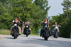 Iron Lilies Dana Cooley (L), Lilly James (R), Leticia Cline (back left) and Kissa Von Addams (back rt) out riding during Laconia Motorcycle Week 2016. NH, USA. Sunday, June 19, 2016.  Photography ©2016 Michael Lichter.