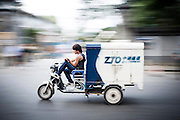 "A Chinese man drives his Courier motorbike while he smokes a cigarette in Beijing, China, July 20, 2014.<br />   <br /> This picture is part of the series ""Urban Chinese Streets"", a journey on the streets of Chinese cities to discover their modern citizens and habits.        <br /> <br /> © Giorgio Perottino"