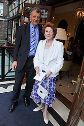 The HON.WILLIAM SHAWCROSS and LADY ELIZABETH ANSON at a reception hosted by the Friends of the Castle of Mey held at the Goring Hotel, Beeston Place, London on 22nd May 2012.