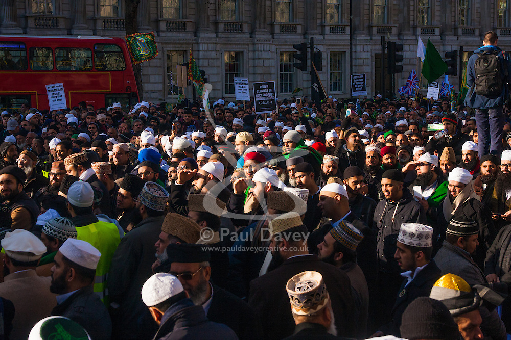 London, February 8th 2015. Muslims demonstrate outside Downing Street  to denounce the uncivilised expressionists reprinting of the cartoon image of the Holy Prophet Muhammad. PICTURED: Thousands of Muslims listen to the various addresses by community leaders.