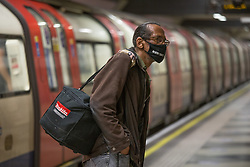 © Licensed to London News Pictures.  14/07/2021. London, UK. A members of the public uses London Underground network as face covering must be worn on London's transport despite easing Lockdown restriction on 19 July. Photo credit: Marcin Nowak/LNP