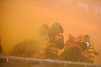 2020.02.16 Bialystok Pilka nozna PKO Ekstraklasa sezon 2019/2020 Jagiellonia Bialystok ( zolto-czerwone ) - Korona Kielce N/z kibice na trybunach chronia sie przed dymem z odpalonych przez kiboli rac fot Michal Kosc / AGENCJA WSCHOD
